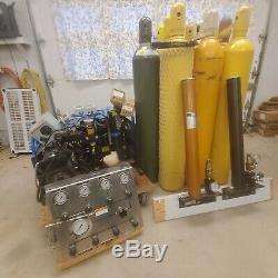 Scuba air compressor, storage bottles, fill station and filter stacks